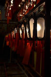 Lanterns in a temple. Line of burning lanterns in a temple Royalty Free Stock Images