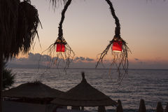Lanterns on terrace by the sea Stock Photo