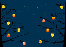 Lanterns on the tree. And night sky Stock Images