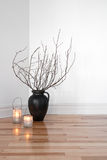 Lanterns and tree branches decorating a room Stock Images