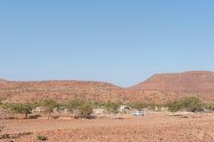 Lantgårdlandskap bredvid C40en-road Arkivbild