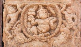 Lantlig form av den hinduiska Herren på väggen av templet, Indien Pattadakal, UNESCOvärldsarv, 7th och 8th-århundrade Royaltyfri Bild