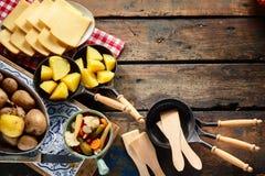 Lantlig gräns av ingredienser för raclette royaltyfria bilder