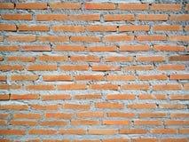 Lantlig orange bakgrund för tegelstenvägg med cementdeg Royaltyfria Foton