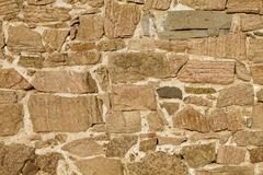 Lantlig stenhällväggbakgrund Arkivfoton