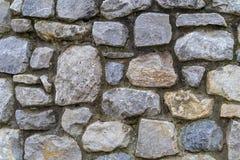 Lantlig stenvägg för tappning - högkvalitativ textur/bakgrund royaltyfria foton