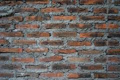 Lantliga tegelstenar och cementtexturvägg för bakgrundsbruk Royaltyfri Bild