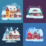 Lantliga vinterhus- och kabinlandskap Arkivbild