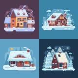 Lantliga vinterhus- och kabinlandskap Arkivfoton
