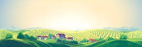 Lantligt panorama- landskap med en by och kullar arkivfoton