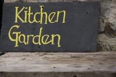 Lantligt tecken för kökträdgård Arkivbild