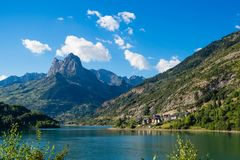 Lanuza village in spanish Pyrenees, landscape mountais and lakes. Lanuza village in spanish Pyrenees, landscape mountains, clouds,village and lakes stock photography