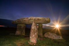 Lanyon Quoit Cornwall England UK. During sunset with sunburst Stock Image