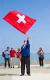 Lanzador suizo de la bandera Fotografía de archivo