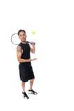 Lanzamiento casual de la pelota de tenis Foto de archivo