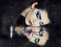 Lanzamiento cosmético de la moda del maquillaje fotografía de archivo