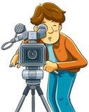 Lanzamiento del cameraman el cine con la cámara de película Imagen de archivo