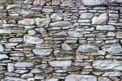 Lanzamiento delantero de la pared de piedra de las toneladas azules de la albañilería como muestra de la textura foto de archivo