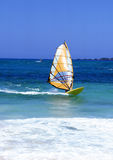 Lanzarote. Windsurfer on Lanzarote, Canary Islands in a turquoise sea with white surf Royalty Free Stock Photo