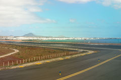 Lanzarote airport runaway with view on the city Royalty Free Stock Photography