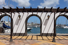 Lanzarote, Canary Islands, Spain. Beautiful portico in Marina Rubicon, a small sailing port on the south of Lanzarote Island, Canary Islands, Spain Stock Image