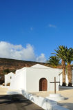 Lanzarote church. Church in Spanish architectural style in Los Valles, Lanzarote showing cross in plinth in churchyard Royalty Free Stock Photos