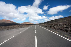 Lanzarote, empty road in a volcanic landscape Stock Image