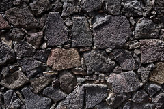 Lanzarote lava stone black masonry wall Stock Photos