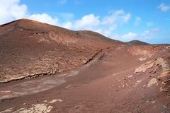 Lanzarote like Mars. Red mountains and ground of Lanzarote who remember the Red Planet. Lanzarote like Mars. Red mountains and ground of Lanzarote who remember Royalty Free Stock Image