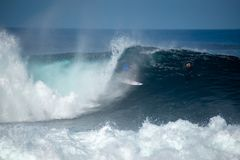Surfer in the big wave stock photo