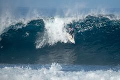 Surfer in the big wave royalty free stock images