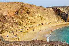 Group of people relaxing on Papagayo beach on the island of Lanzarote, Spain Stock Photography