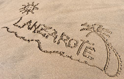 Lanzarote sandwriting på stranden Arkivbilder