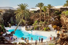 Jameos del Agua pool in Lanzarote. Lanzarote, Spain - DECEMBER 02, 2017: Tourists are walking and taking pictures in Jameos del Agua garden in Lanzarote, Canary stock images