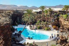 Jameos del Agua pool in Lanzarote. Lanzarote, Spain - DECEMBER 02, 2017: Tourists are walking and taking pictures in Jameos del Agua garden in Lanzarote, Canary stock photos