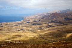 Lanzarote view  house field coastline. Lanzarote view from the top in  spain africa and house field coastline Royalty Free Stock Photos