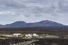 Lanzarote village and mountains of fire Stock Images