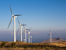 Wind Farm Turbines - Renewable Clean Green Energy. Onshore wind turbines producing renewable clean green energy in a volcanic landscape. Los Valles, Lanzarote stock photos
