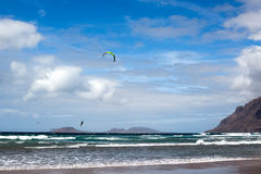 Lanzarote, windsurfing on the Famara beach, Canary Islands. Famara beach popular place for watersports thanks to the swell of the waves and constant winds. Spain stock photo