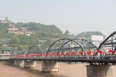 LANZHOU, CHINA - OCT 2 2014: Sun Yat-Sen Bridge (Zhongshan Qiao). A famous First Bridge across the Yellow River in Lanzhou, Gansu, China Royalty Free Stock Photos