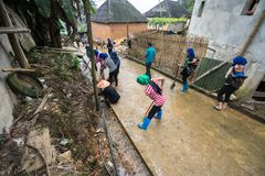 Lao Cai, Vietnam - Aug 30, 2017: Volunteers - the farmers cleaning village road on a regular social activity in Y Ty, Bat Xat dist. Rict Royalty Free Stock Photo
