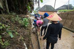 Lao Cai, Vietnam - Aug 30, 2017: Volunteers - the farmers cleaning village road on a regular social activity in Y Ty, Bat Xat dist. Rict Royalty Free Stock Photography