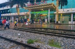 Lao Cai train station with tourists and locals on rainy day Royalty Free Stock Images