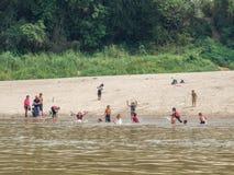 Lao kids playing in the Mekong River. Luang Phabang, Laos, Asia stock photos