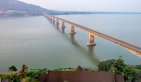 Lao Nippon Bridge in Pakse Laos. The Lao Nippon bridge across the Mekong River in Pakse Laos Royalty Free Stock Photography