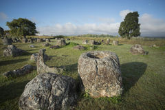 LAO PHONSAVAN PLAIN OF JARS. The plain of jars sit1 in the morning near the town of Phonsavan in the province Xieng Khuang in north Lao in southeastasia Stock Image