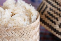 Lao Sticky Rice. Sticky rice in a traditional woven, wicker container with lid Royalty Free Stock Image