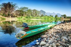 Lao Traditional boats on the shore of a mountain river. Traditional boats on the shore of a mountain river Stock Photos