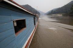 Laos. A boat sail the mekong river in laos Stock Photo