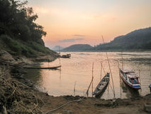 Laos Boats on the Mekong River at Sunset Royalty Free Stock Images